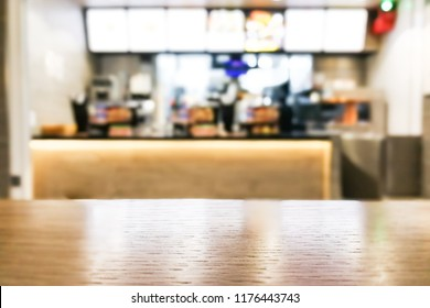 Table foreground with blurred fast food counter background as graphic resources