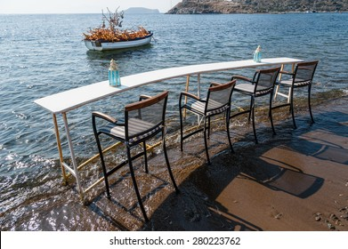 A table for four diners at a seaside restaurant in Turkey.