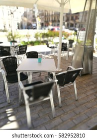 Table for four at a restaurant terrace during a sunny day