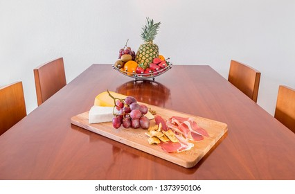 Table with fruit and food in a wooden table. Healthy lifestyle concept.