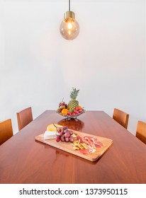 Table with fruit and food in a wooden table. Healthy lifestyle concept.Spacious modern interior