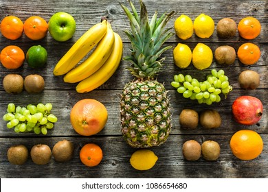 Table with fruit, tropical variety of mixed fruits on wooden background, healthy food and clean eating concept
