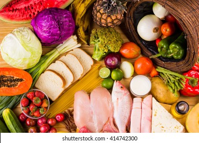 table full of all kinds of food in our daily diet includes proteins, carbohydrates, fats, vegetables and fruits