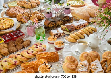 Table full of assorted confectionery sweets and desserts