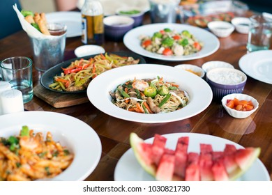 A table full of delicious dishes from various countries.