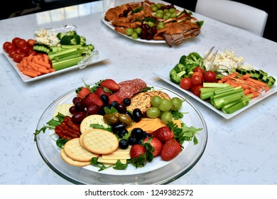 Table full of various food party platters