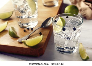 Table with gin tonic glasses and ingredients over it