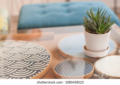 Table with glass top Small tree In the pot Beautiful fabric decorate