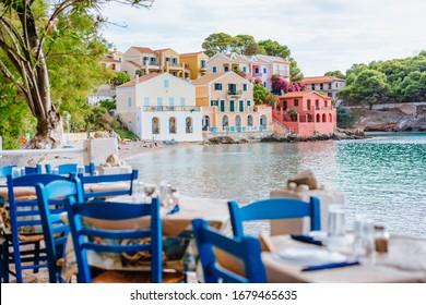 Table in Greek tavern in Assos fishing village, Kefalonia island, Greece