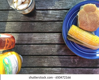Table with Grilled Food on Plate