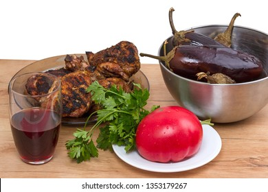 Table with Grilled meat, vegetables and red wine