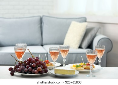 Table at home with food and drinks for friends