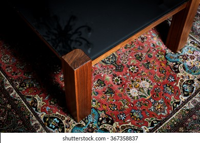 Table  and knitted carpet