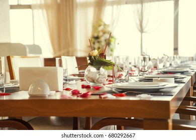 the table is laid for celebration, there are glasses and salad and snack, toned