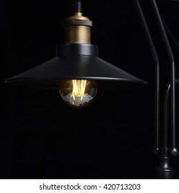 table lamp loft style. isolated on black background, switches on