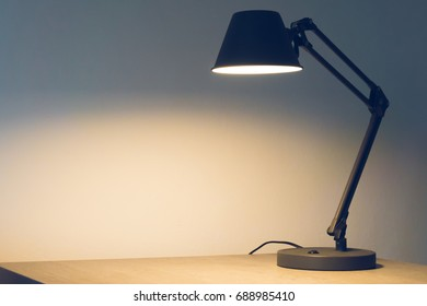 A table lamp is on the table
