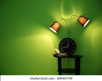 Table and lamp on green wall background