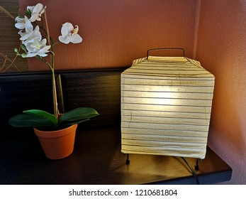 Table lamp with warm light stand in the corner of the dark