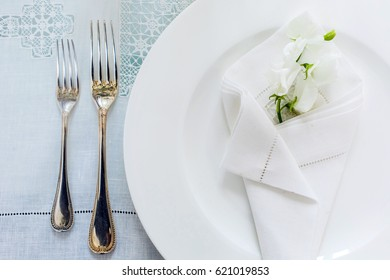 Table layout. A plate with a flower and tableware