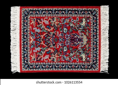 Table mat for hot drinks looking like a carpet, isolated on black background