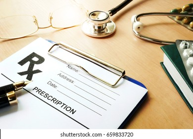 Doctor's table with medical prescription form. Healthcare concept.