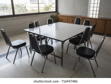 A Set Of Table And Chairs In An Office EZ Canvas - Conference room table and chairs set
