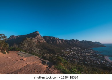 Table Mountain and Camps Bay photohtaphed from Lion's Head with the Twelve Apostels in the background, in Cape Town, South Africa