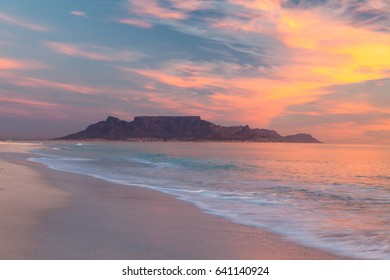 Table mountain in cape town south africa scenic view from bloubergstrand at sunset