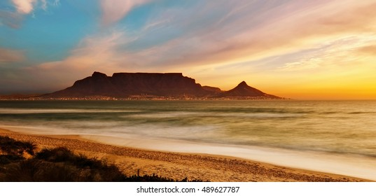 Table Mountain Panoramic Landscape with Beautiful Colorful Sunset and Streaking Clouds Landscape, Cape Town, South Africa