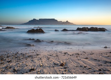 Table Mountain view from Blouberg Beach at sunset