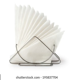 A table napkin holder with white napkins isolated on white background