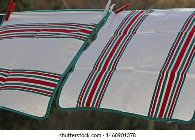 table napkins hanging out to dry on a breezy day in Italy showing traditional Italian colours