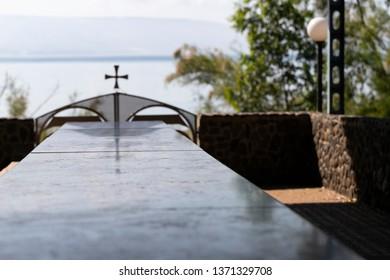Table near Monastery of 12 Apostles, Capernaum, Israel. Kinneret lake on background.