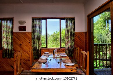 Table next to window and terrace door inside restaurant. Shot in Sodwana Bay campsite, KwaZulu-Natal province, Southern Mozambique area, South Africa.