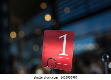 Table number one sign on a cafe restaurant table with a sprinkling light dark background