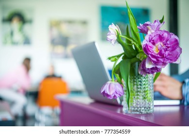 table in the office with a bouquet of flowers tulips