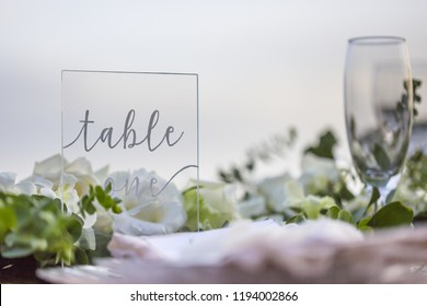 Table One Perspex Table Stand for a Romantic Wedding Table Top Layout Table Spread no people no human tropical location with gold cutlery and scenic view