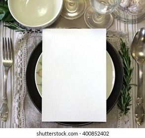 Table place, reserved card, menu mockup.  Vintage fashion photography. Wedding dinner design. Beautiful dishware. European traditional style.