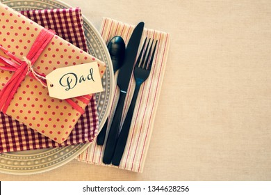 Table Place Setting for Dad for a Birthday Party or Father's Day Celebration Dinner and background room or space for copy, text or words.  Horizontal with cross process tint and flat layout