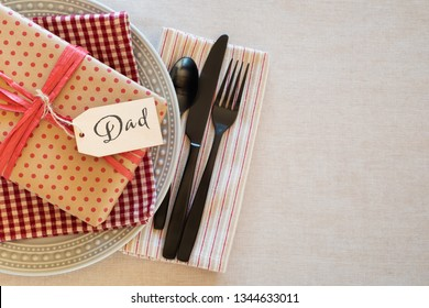 Table Place Setting for Dad for a Birthday Party or Father's Day Celebration Dinner and background room or space for copy, text or words.  Horizontal with Flay layout and above view