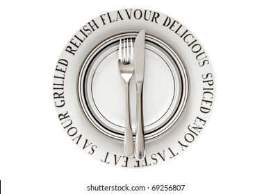 Table place setting with decorative plates isolated on a white background