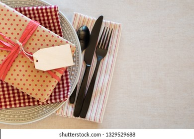 Table Place Setting for a Man or Boy for a Birthday Party or Father's Day Celebration Dinner and background room or space for copy, text or words.  Horizontal with Flay layout and above view