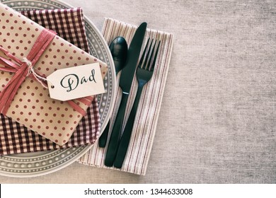 Table Place Setting for a Man or Boy for a Birthday Party or Father's Day Celebration Dinner and background room or space for copy, text or words.  A grunge Horizontal with Flay layout and above view