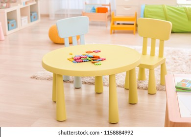 Table with puzzle pieces at child psychologist's office. Autism concept