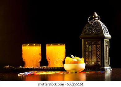 Table with Qamar El Din ( Apricots Juice) and Ramadan fanous (lantern) ready for happy breakfast in Ramadan