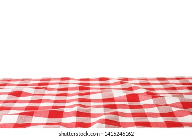 Table with red checkered cloth isolated on white