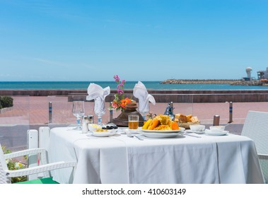 Table in restaurant  with moroccan food on the seafront. Agadir, Morocco