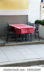 table in the restaurant, on the sidewalk of the street