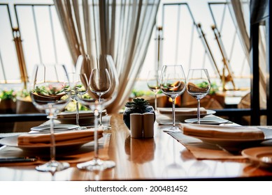 Table in restaurant served for lunch. Photo with beautiful bokeh.