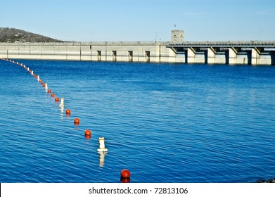Table Rock Lake Dam in Branson, Missouri Buoys floating on top of the water with snow on the bank rocks